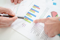 Assistant showing graphs to her boss Royalty Free Stock Image