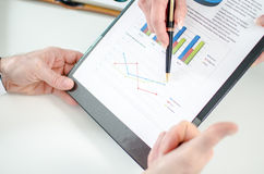 Assistant showing graphs to her boss Stock Images