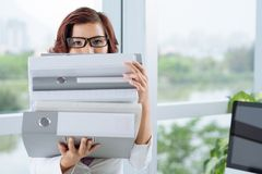 Assistant with a stack of binders Royalty Free Stock Photo