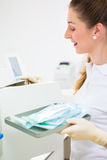 Assistant with sterile dentist tools Stock Image