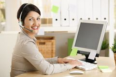 Assistant talking on headset Royalty Free Stock Images