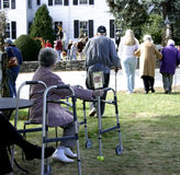 Assisted Living. Elderly generation using walking aids such as canes, walkers and companions Royalty Free Stock Photo