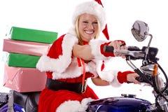 Assistente delle Santa che trasporta i regali sul motociclo Immagine Stock Libera da Diritti