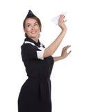 Assistente di volo con un aeroplano di carta Immagini Stock Libere da Diritti