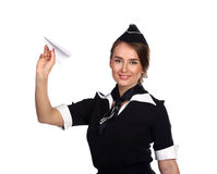 Assistente di volo con un aeroplano di carta Fotografia Stock Libera da Diritti