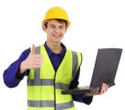 Assistente tecnico con un computer portatile immagine stock