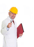 Assistente tecnico esperto in casco giallo fotografie stock