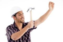 Assistente tecnico nell'azione con il martello Immagine Stock