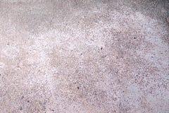 Assoalho cinzento do cimento da quebra velha foto de stock