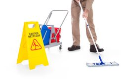 Assoalho da limpeza da vassoura com sinal de aviso Foto de Stock Royalty Free
