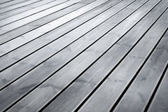 Assoalho molhado da madeira do terraço Foto de Stock