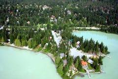 Assobiador verde do lago, Columbia Britânica, Canadá Fotografia de Stock Royalty Free