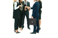 Associés de réunion et une poignée de main lors de la réunion Photo libre de droits