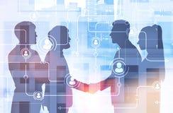 Associés se serrant la main, réseau de personnes images stock