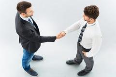 Associados de negócio que agitam as mãos imagens de stock royalty free