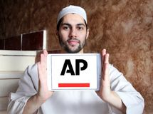 Associated Press , AP , logo. Logo of Associated Press , AP , on samsung tablet holded by arab muslim man. The Associated Press AP is a U.S. based not for profit Stock Images