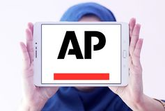 Associated Press , AP , logo. Logo of Associated Press , AP , on samsung tablet holded by arab muslim woman. The Associated Press AP is a U.S. based not for Stock Image