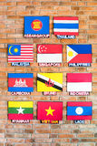 Association of Southeast Asian Nations Flags. Arrange beside the brick wall Royalty Free Stock Photography