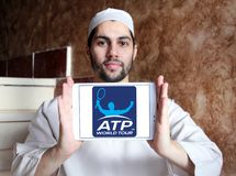 Association of Tennis Professionals, ATP logo. Logo of Association of Tennis Professionals, ATP on samsung tablet holded by arab muslim man Royalty Free Stock Images