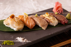 Assorted Aburi (Torched) Sushi. Assorted torched sushi on a black stone plate Royalty Free Stock Images