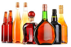 Assorted alcoholic beverages on white Stock Images