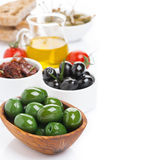Assorted antipasti - olives, pickles, olive oil and ciabatta Royalty Free Stock Photography