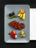 Assorted antipasti on a platter Stock Image