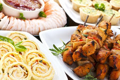 Assorted appetizers. Many dishes of bite size appetizers and party food royalty free stock photos