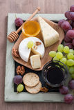Assorted appetizers to wine - cheese, fresh grapes, crackers Royalty Free Stock Photo
