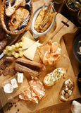 Assorted Appetizing Tapas on Wooden Board Stock Photography
