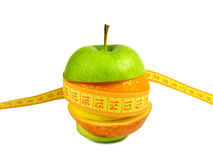 Assorted apple with metre measure ruler. On the white background Stock Images