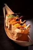 Assorted Asian spices in brown paper packets Stock Image