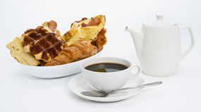 Assorted baked bread and coffee. Assorted baked bread and hot a coffee Royalty Free Stock Photography