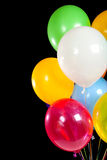 Assorted balloons on a black background Royalty Free Stock Photography