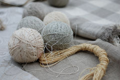 Assorted balls of natural colored yarn Royalty Free Stock Photo