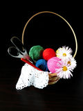 Assorted balls of yarn in a basket. Set of multicoloured yarn for knitting stock photos