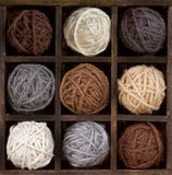 Assorted balls of yarn in a box Royalty Free Stock Photos