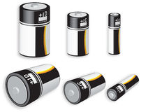 Assorted Batteries. 3D rendering of three different battery sizes isolated on white background Royalty Free Stock Image