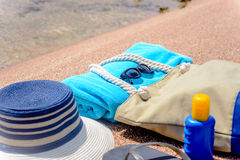 Assorted beach accessories on the sand Royalty Free Stock Photos