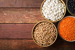 Free Assorted Beans In Bowls With Red Lentil, Chick-pea And Kidney Bean On Wooden Background. Stock Photography - 97196812
