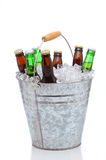 Assorted beer bottles in a bucket of ice Royalty Free Stock Photography