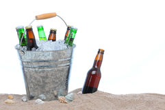 Assorted beer bottles in a bucket of ice Royalty Free Stock Photos