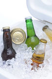 Assorted Beer Bottles and Cans in Cooler Stock Image