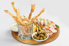 Assorted beer snack, cheeses, wallnuts and other Royalty Free Stock Images