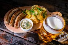 Assorted beer snacks with beer mug royalty free stock photo