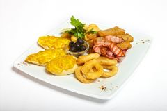 Assorted beer snacks on plate. And white background royalty free stock image