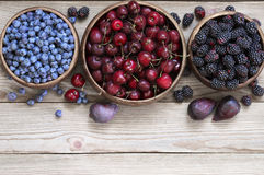 Assorted berries in bowls Royalty Free Stock Images