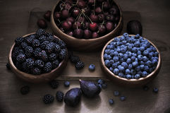 Assorted berries in bowls Royalty Free Stock Photos