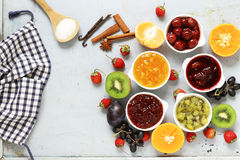 Assorted berries and fruit jams. Homemade canning. Fresh berries and fruits Royalty Free Stock Image