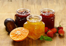 Assorted berries and fruit jams. Homemade canning. Fresh berries and fruits Royalty Free Stock Photos